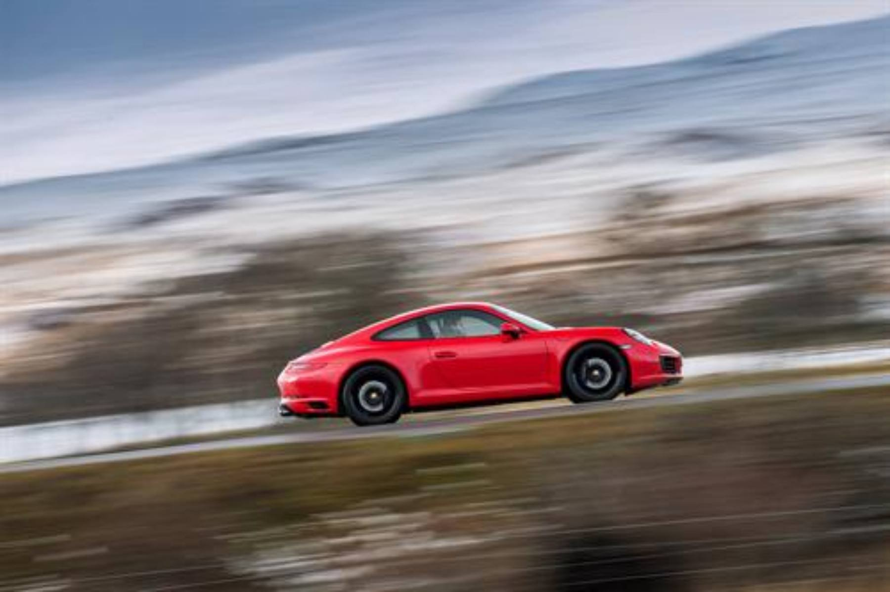 Porsche puts brake on all-electric 911